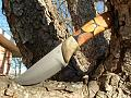 blade made from mans grandfathers rock chisel..handle made from casted agirita wood.